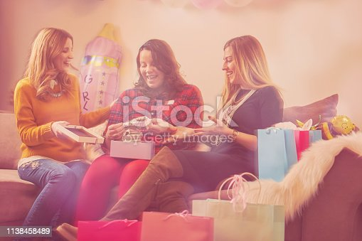 609058672 istock photo Pregnant woman celebrating baby shower party with friends. 1138458489