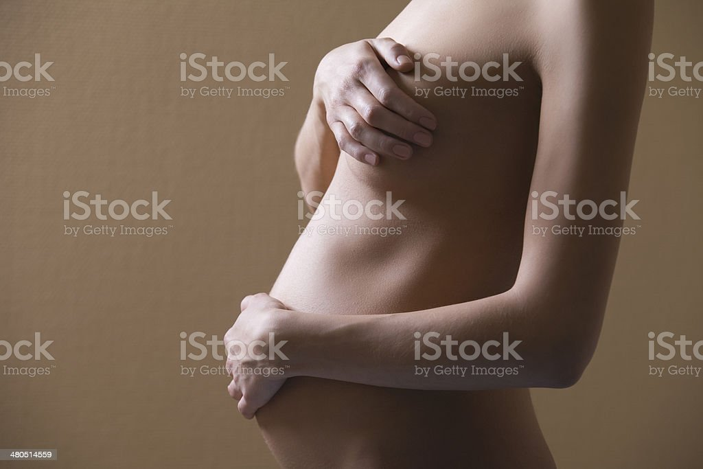 Pregnant Woman Covering Breast And Abdomen royalty-free stock photo