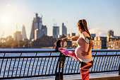 istock Pregnant woman does her stretching in London 1061673680