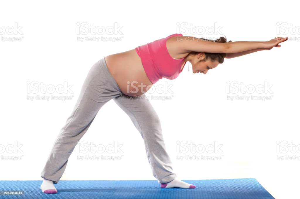 Pregnant woman doing exercises on white background royalty-free stock photo