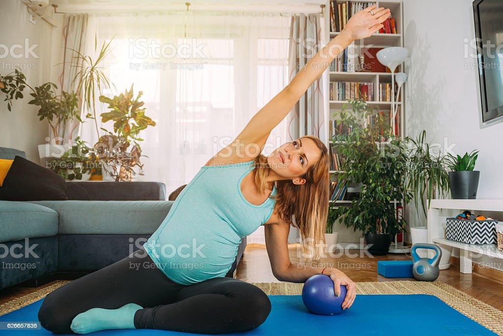 Pregnant woman doing yoga stock photo