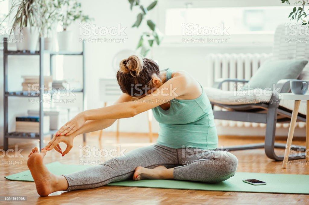 Pregnant woman exercise stock photo