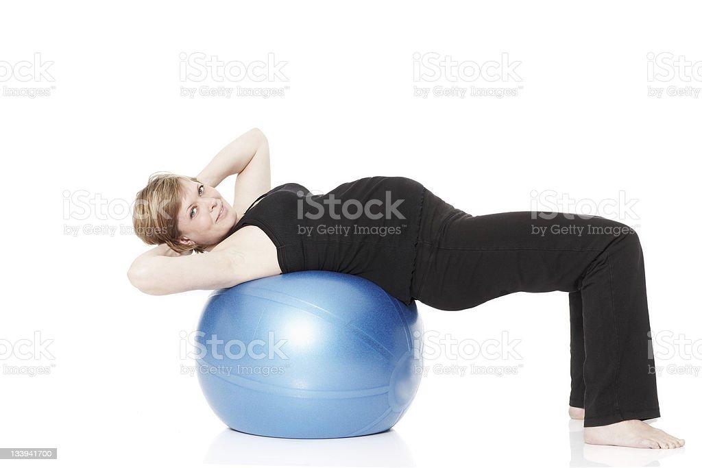 Mujer embarazada ejercicio - Foto de stock de Acostado libre de derechos