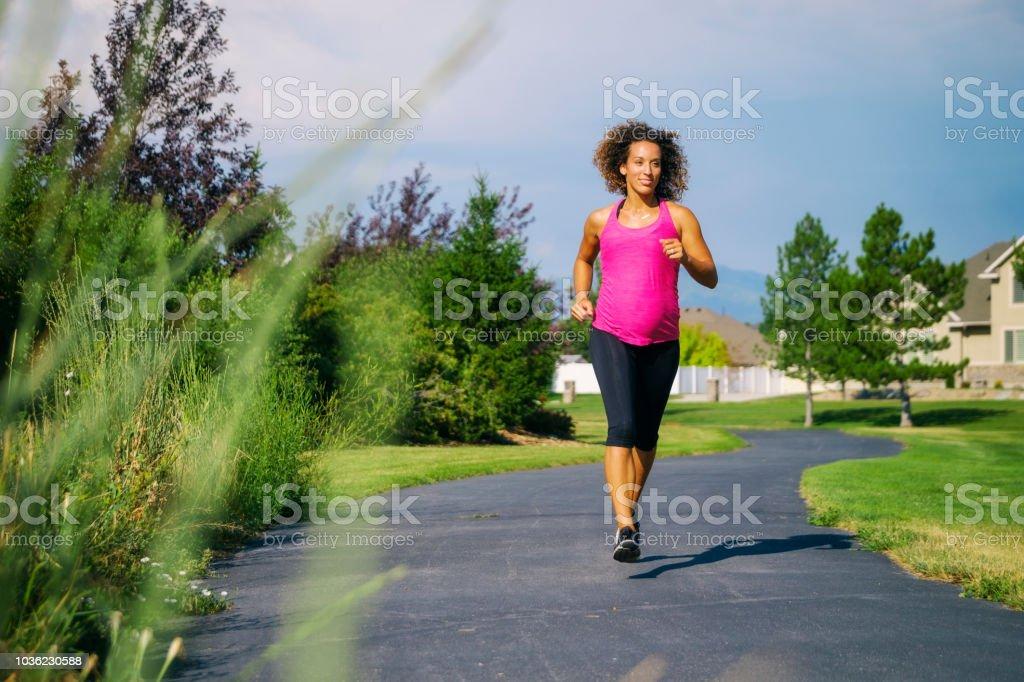 Pregnant Woman Fitness Exercise stock photo
