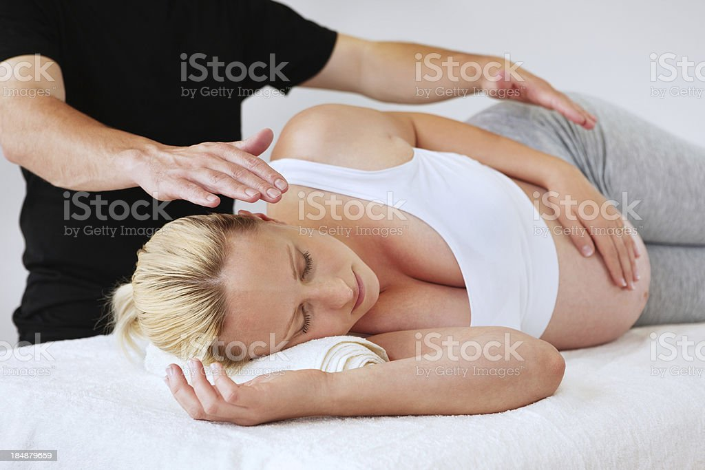 Pregnant Woman Getting New Age Therapy stock photo
