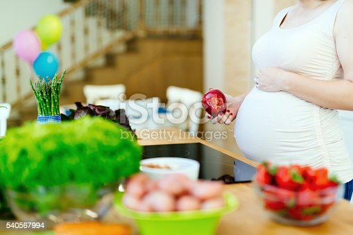 istock Pregnant woman healthy diet 540567994