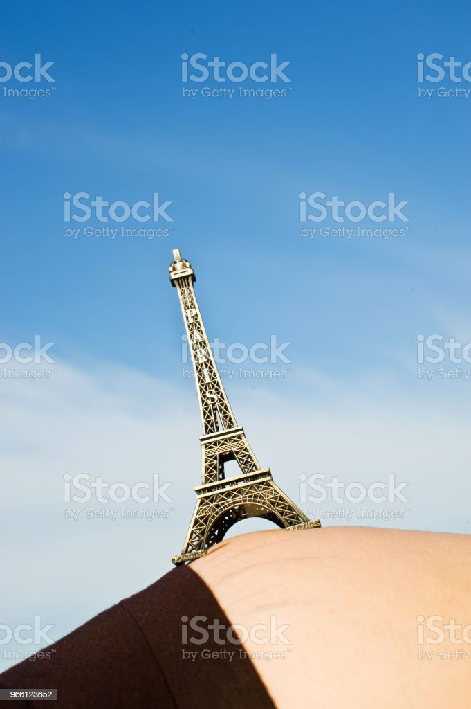 Pregnant Woman Hold Up The Eiffel Tower Replica - Royalty-free Africa Stock Photo