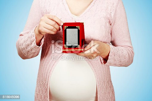 istock Pregnant woman holding a plaque for Mother's day 515645096