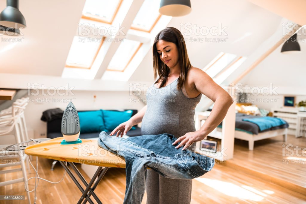 pregnant woman ironing royalty-free stock photo