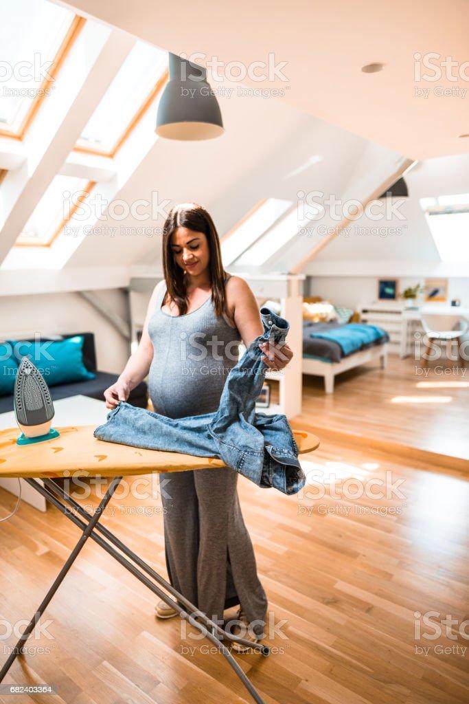pregnant woman ironing royalty-free stock photo