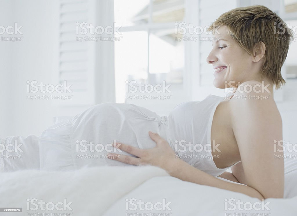 Pregnant woman looking at stomach royalty-free stock photo