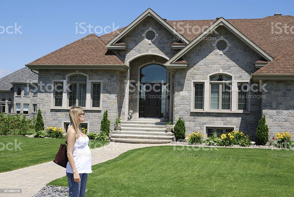Pregnant woman looking for a new house royalty-free stock photo