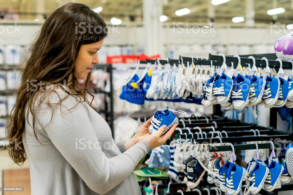Pregnant Woman making shopping stock photo