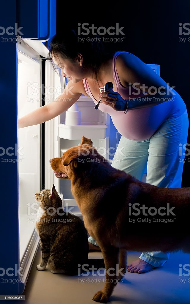 Pregnant woman midnight snack royalty-free stock photo