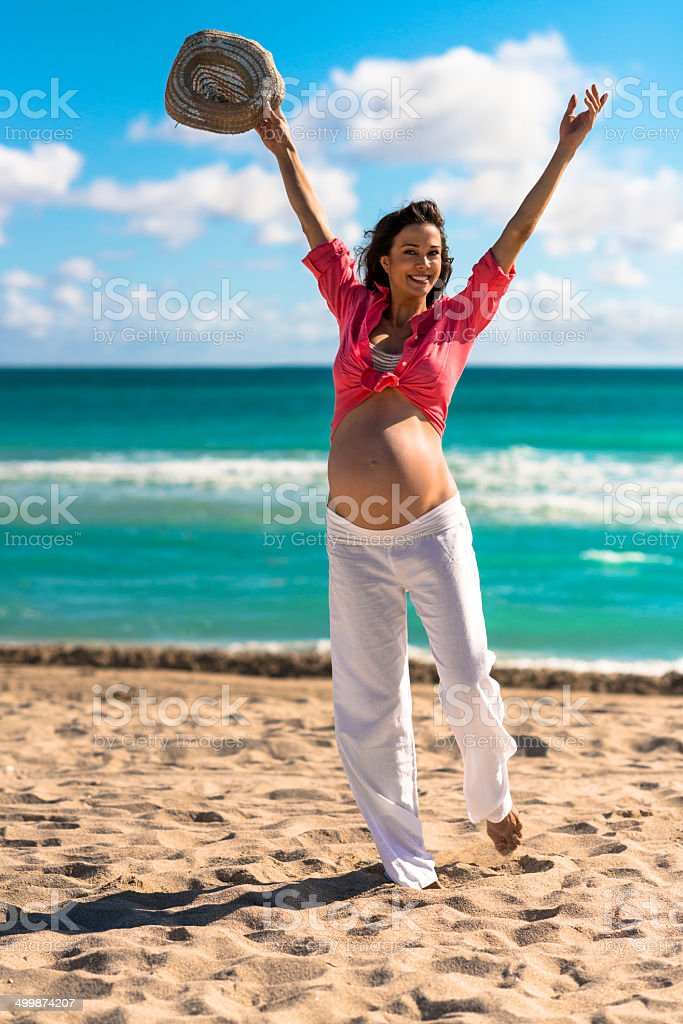 Pregnant Woman on Beach royalty-free stock photo