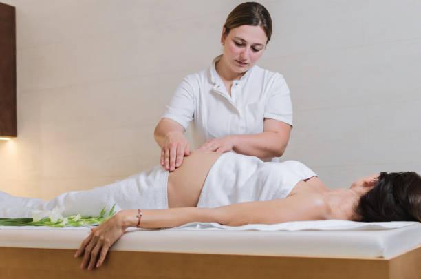 Pregnant woman on massage stock photo