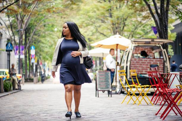 Pregnant woman out and about stock photo