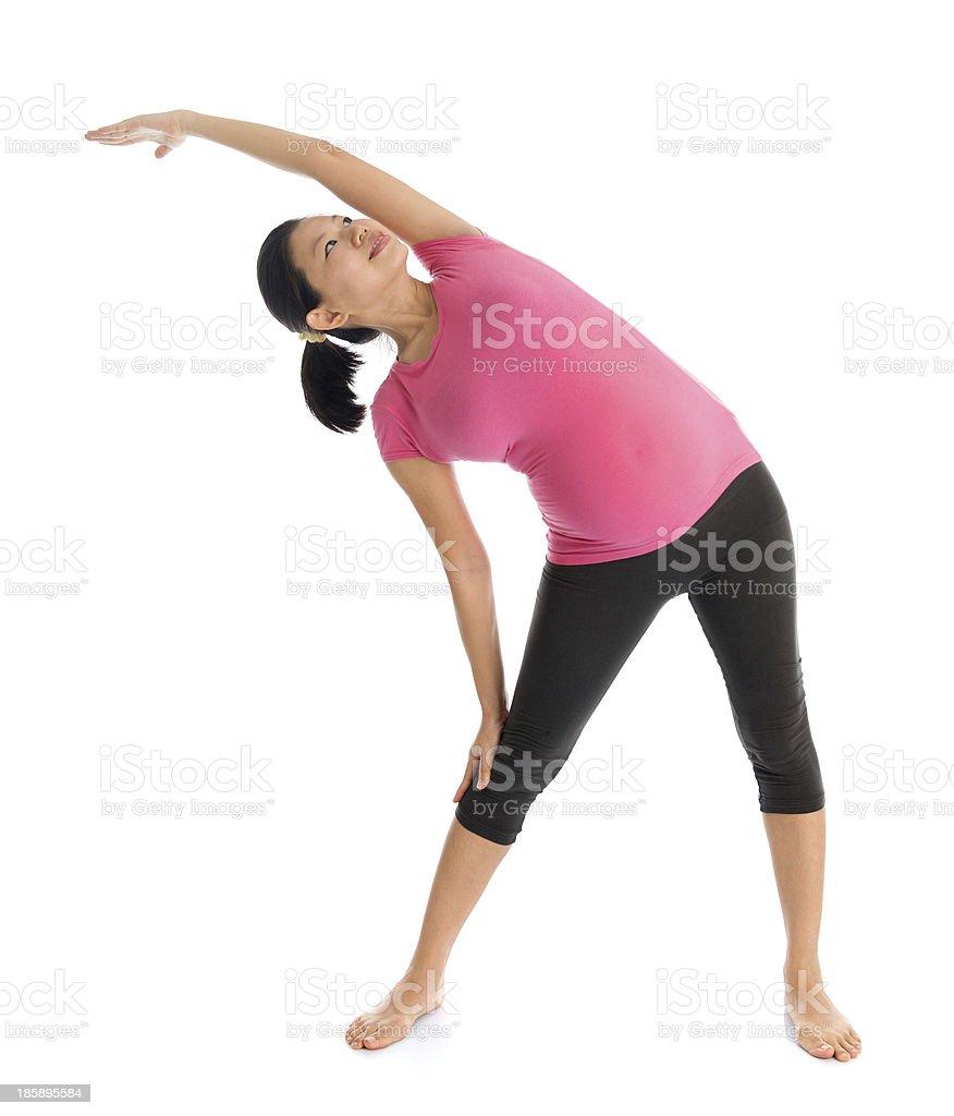 Pregnant woman practicing prenatal yoga on white background stock photo