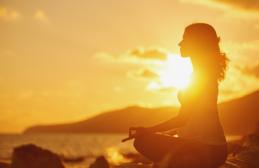 1071305850 istock photo Pregnant woman practicing yoga in lotus position on beach 481288428