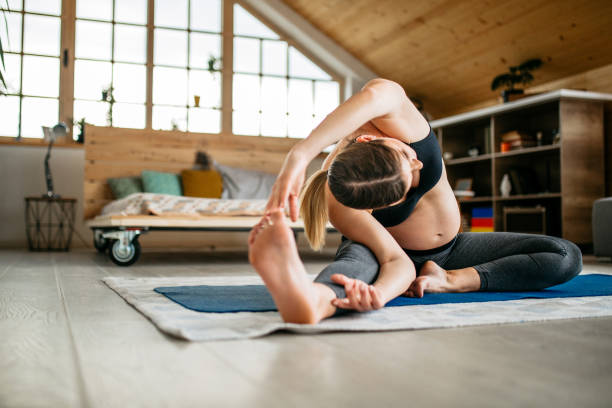 Pregnant woman practicing yoga in the morning stock photo