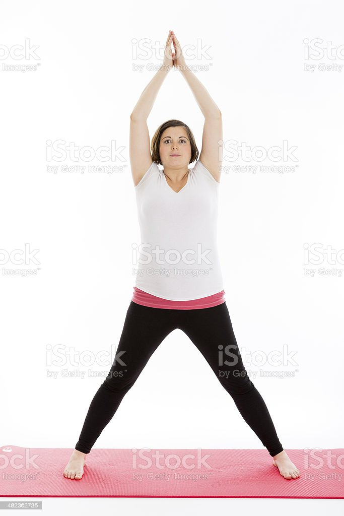 Pregnant woman practicing yoga royalty-free stock photo