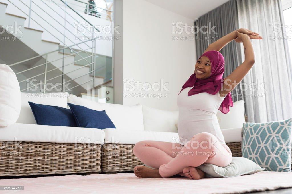 Pregnant woman practicing yoga stock photo