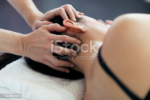 609830806 istock photo Pregnant woman receiving osteopathic or chiropractic treatment in neck in a clinic. 1162962024