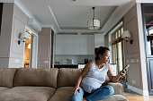 istock Pregnant woman relaxes at home 1177481052