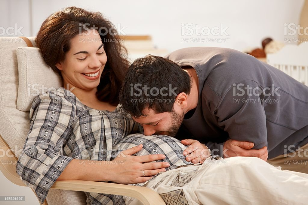 Pregnant Woman Relaxing Husband Kissing Belly Stock Photo ...
