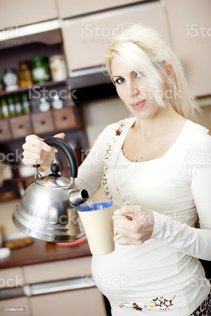 Pregnant woman relaxing royalty-free stock photo