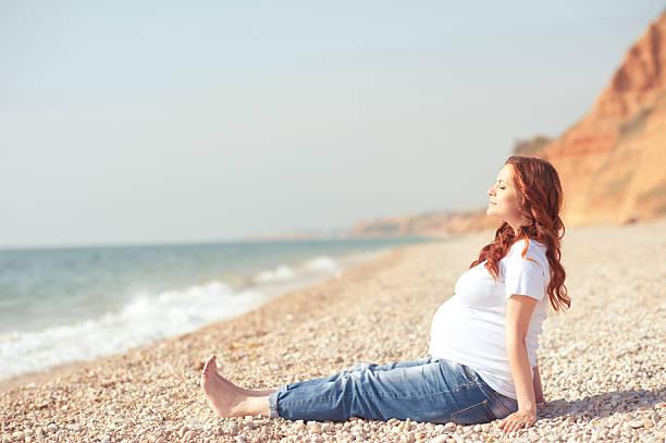 Pregnant woman resting stock photo
