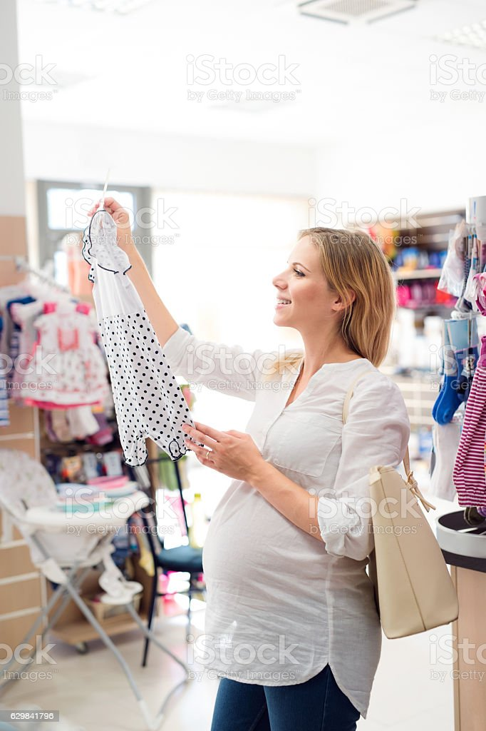Pregnant woman shopping clothes for her baby – Foto