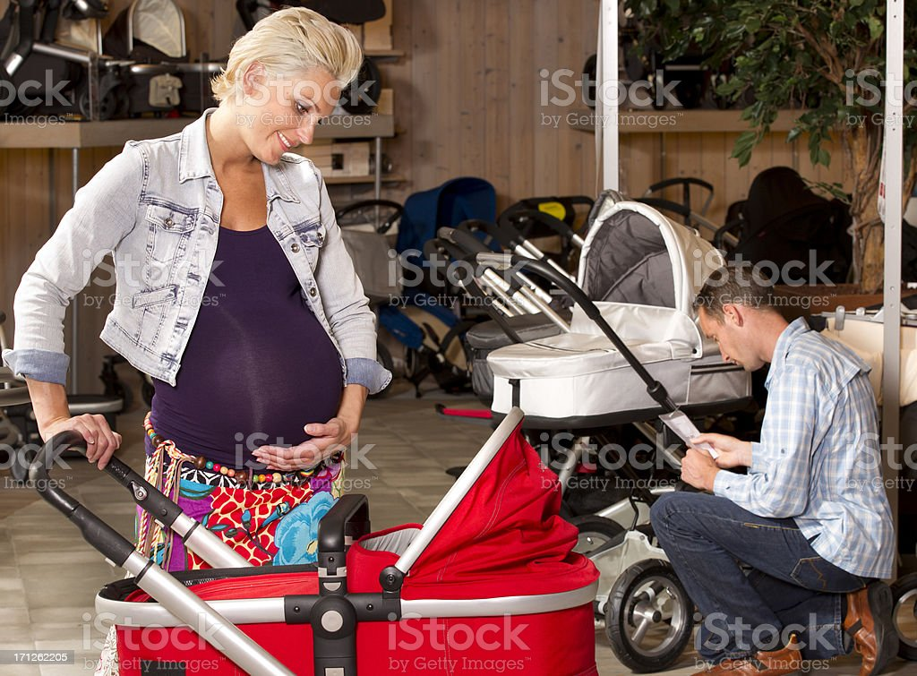 Pregnant woman, shopping in baby shop stock photo