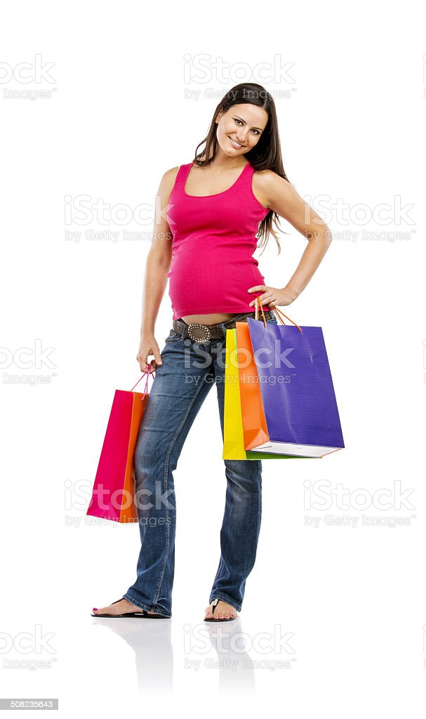 Pregnant woman shopping isolated on white stock photo