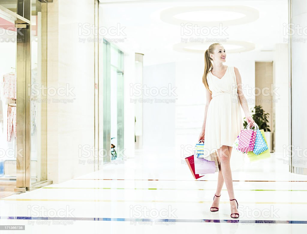 Pregnant woman shopping royalty-free stock photo