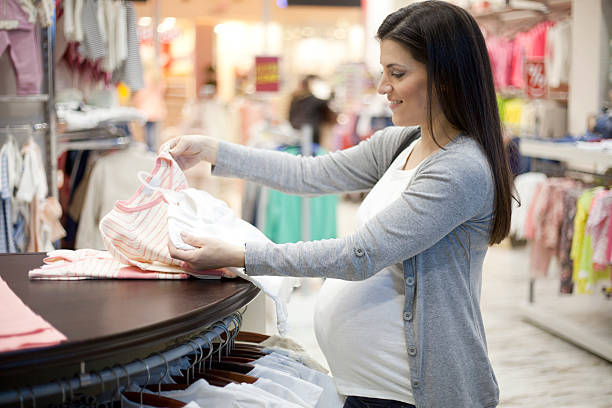 Pregnant woman shopping stock photo