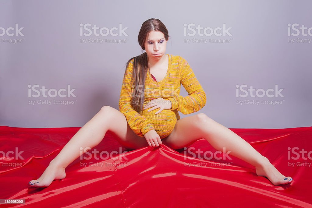 pregnant woman sitting and practicing exercises royalty-free stock photo