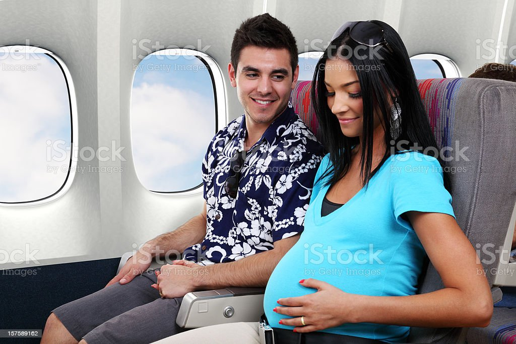 Pregnant Woman Traveling On Airplane stock photo