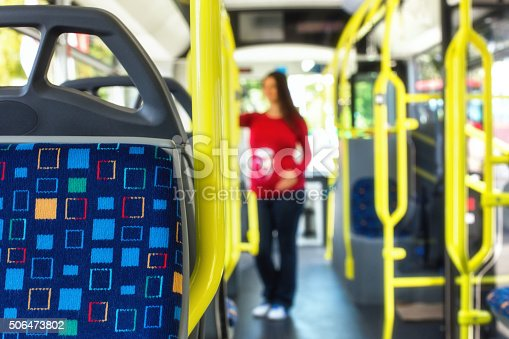 istock Pregnant woman travelling with public autobus or tramway, during 506473802