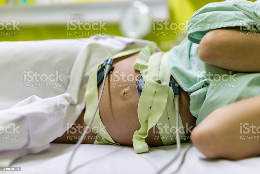 Pregnant woman undergoing cardiotocography stock photo
