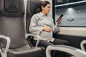 Pregnant woman using the subway