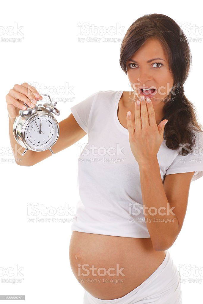 Pregnant woman with an alarm clock royalty-free stock photo