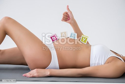istock pregnant woman with baby word 855752822