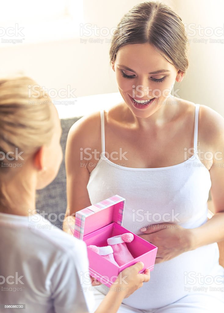 Pregnant woman with daughter royalty-free stock photo