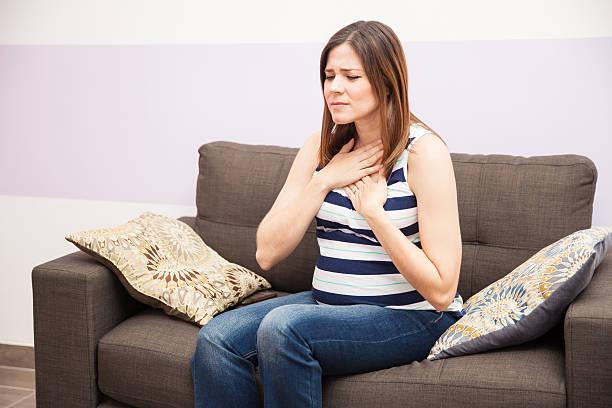 Pregnant woman with heartburn stock photo