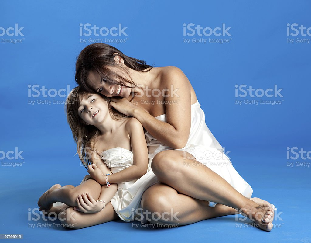 Pregnant woman with her daughter royalty free stockfoto