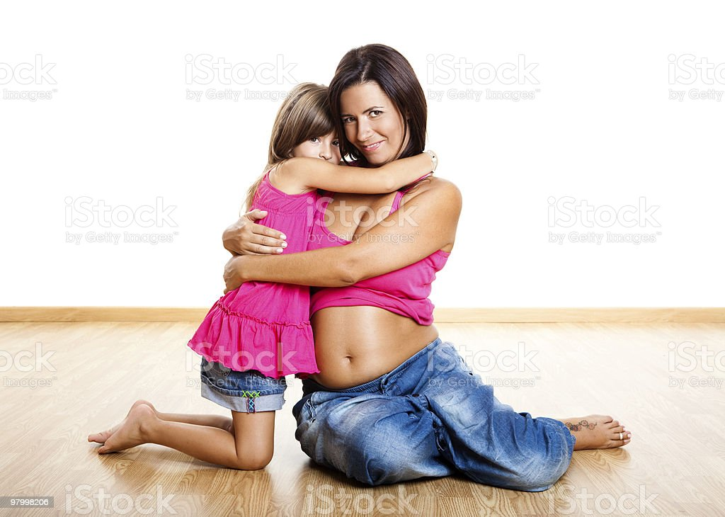 Pregnant woman with her daughter royalty-free stock photo