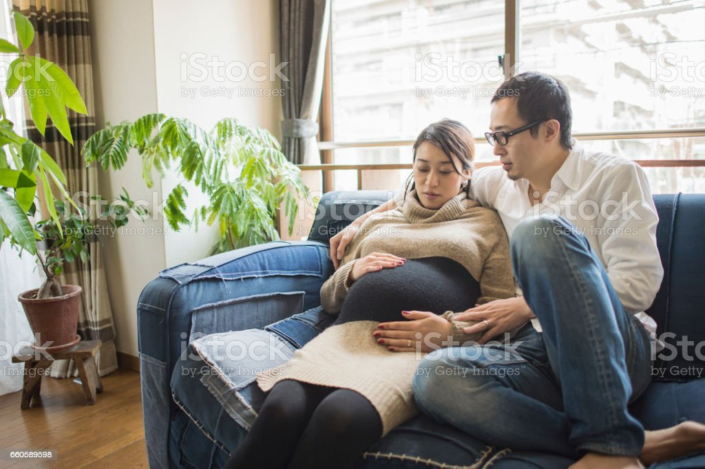 Pregnant woman with her husband in room royalty-free stock photo