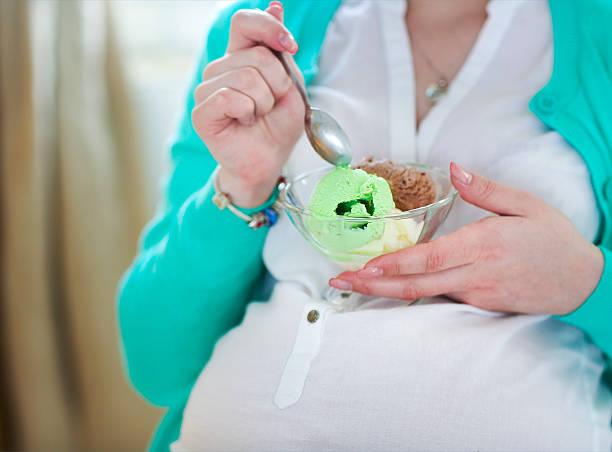 pregnant woman with ice cream - cravings bildbanksfoton och bilder