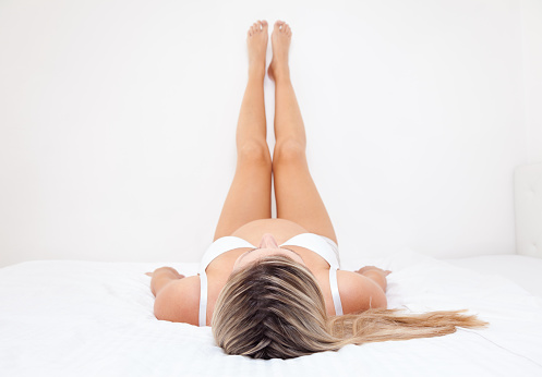 Pregnant Woman With Legs Raised Up Stock Photo - Download Image Now
